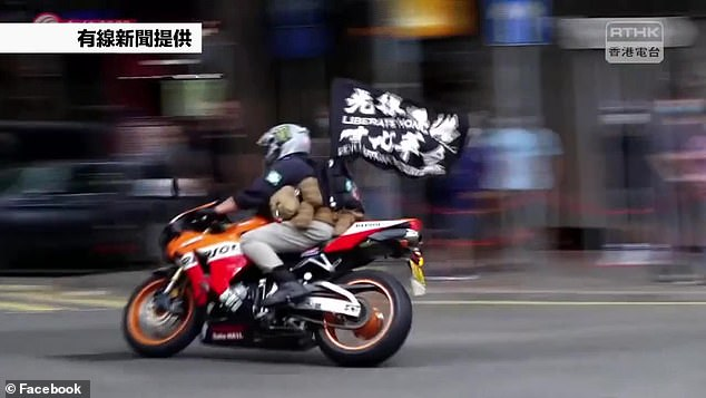 Ying-kit convicted for driving a motorbike into a group of police officers while waving a flag bearing a protest slogan 'Liberate Hong Kong, revolution of our times', on July 1, 2020 (pictured)