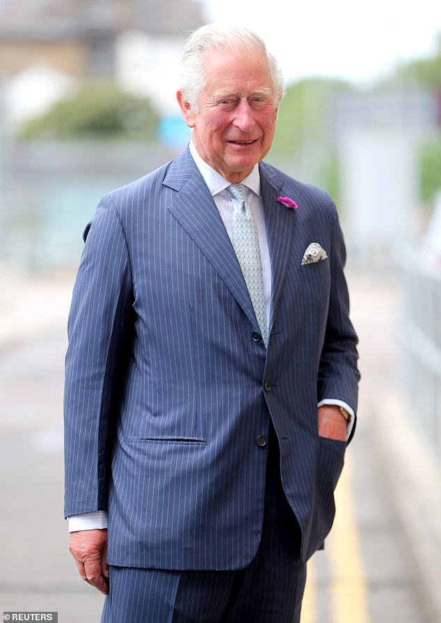 Royal author Nigel Cawthorne has claimed that Prince Charles, 71, plans to 'dampen a sense of entitlement among royals' when he becomes king. Pictured, the royalsmiles as he meets key workers from Transport for London, who have worked throughout the COVID-19 outbreak on July 2