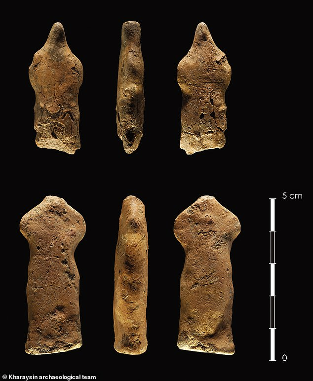Two clay human figurines found at the bottom of a pit located at Kharaysin - these are among objects seen as depicting humans rather than animals