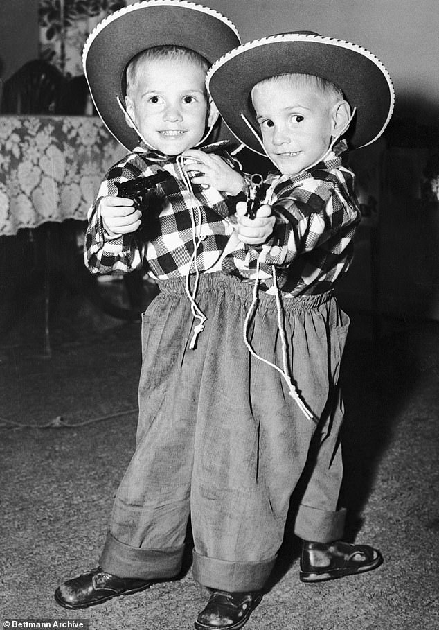 Ronnie and Donnie Galyon pose in their cowboy suits on their third birthday in Dayton. The boys learned how to walk at 29 months, taking turns going backwards. Their father made the decision to take them on the carnival circuit as a way to support his growing family of nine children
