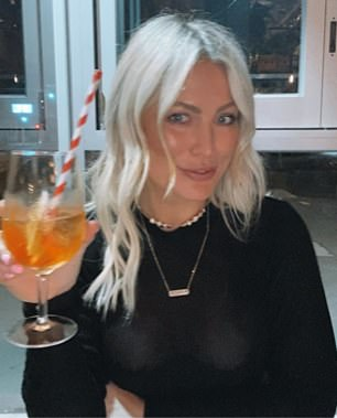 HERS: Keira has deleted this photo holding the Aperol spritz that appeared in Matthew's photo