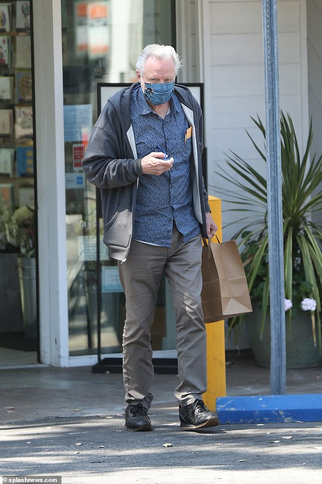 Safety first: Oscar winner Jon Voight protected himself by wearing a cloth mask to grab groceries from Jayde's Market in LA's Bel-Air neighborhood on Sunday