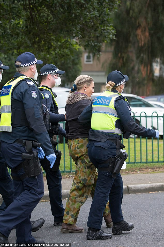 The woman, who wore camo pants, was taken away by police on Tuesday