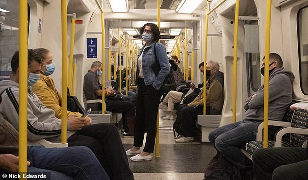 Many passengers were wearing face coverings on the Circle Line this morning, pictured, but there have been cases of people flouting the rules