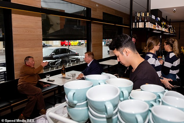 Premier Daniel Andrews said there are now only four valid reasons for residents to leave their homes - work or study, providing or receiving healthcare, essential shopping and exercise. Pictured: Melbourne restaurant Dundas & Faussett preparing to reopen after the first lockdown