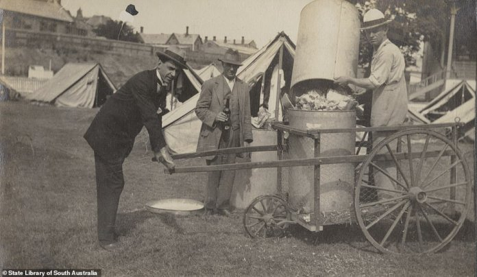 Spanish Flu symptoms were very similar to those of COVID-19 - patients would experience a shortness of breath and their lungs would fill with fluid. Pictured: rubbish collection at Jubilee Oval's quarantine camp in 1919