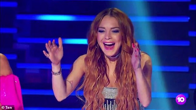 Fun: In the one-minute video, the judges look shocked as they come face to face with celebrity singers such as Kate Ceberano and Cody Simpson who finally unmasked themselves [Pictured Lindsay Lohan]
