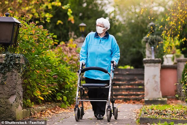 In the photo: an image shows an elderly lady wearing a face mask during the UK coronavirus epidemic
