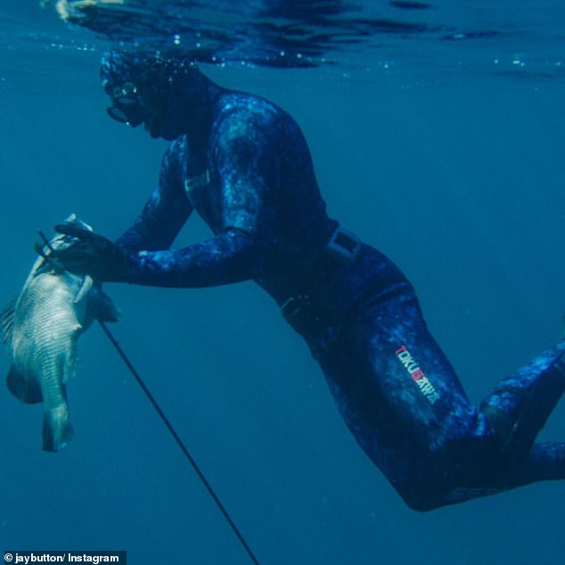 Mr Pullin is pictured spearfishing just a week before tragedy struck