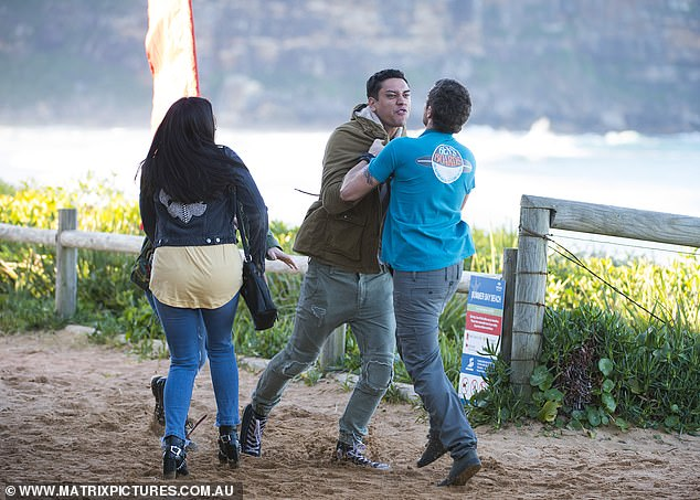 Fuming: Dressed in a khaki jacket and patchwork denims, Kawakawa effortlessly shows off his acting prowess as he grabbed Patrick by the collar