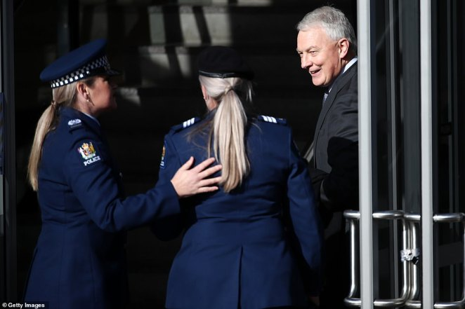 Auckland Mayor Phil Goff (pictured right) held open a door for two officers as they entered the service