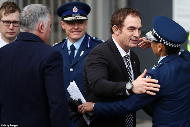 Police Minister Stuart Nash (pictured middle) embraced an officer as he made his way to Mr Hunt's funeral