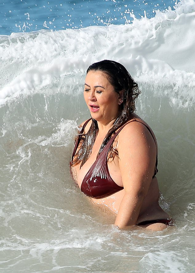 Careful! During Mishel's dip, several crashing wave threatened to displace her flimsy bikini top