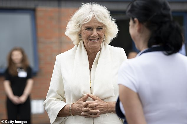 Duchess of Cornwall speaks to a worker during a visit with Prince Charles to the Turnbull & Asser shirt factory in Gloucester