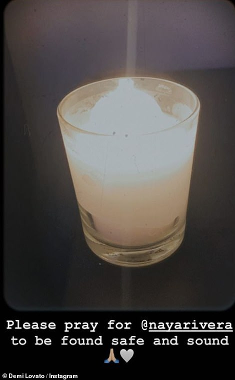 Hoping: Demi shared a picture of a candle and wrote 'please pray for @nayarivera' on Instagram on Thursday