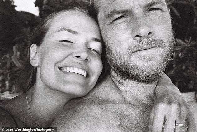 Family: Lara lives in Los Angeles with actor husband Sam Worthington (right). The couple share three sons, Rocket, four, Racer, two, and a newborn son, whose name is unknown