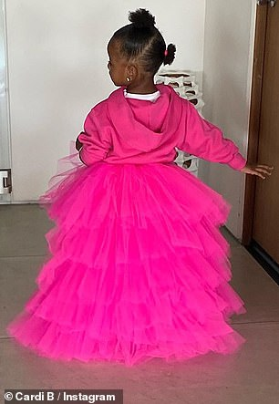 Sweet: Little Kulture happily posed for snaps in her pink outfit