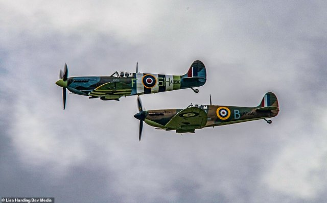 The Spitfire (bottom) and Hurricane after taking off from RAF Coningsby, Lincolnshire, on Friday morning to do a flypast for Vera Lynn's funeral today