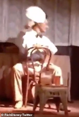 Oh dear: The animatronic character, from Tomorrowland's Carousel of Progress, was caught on camera stuck on an awkward loop during a dress rehearsal ahead of Disney's reopening