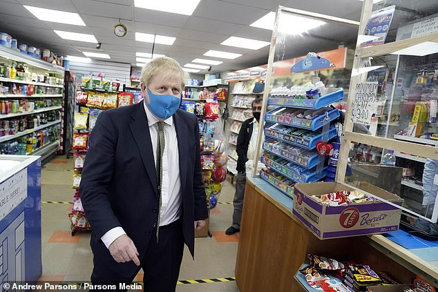 Boris Johnson has been pictured wearing a face mask for the first time in public while out in his Uxbridge constituency