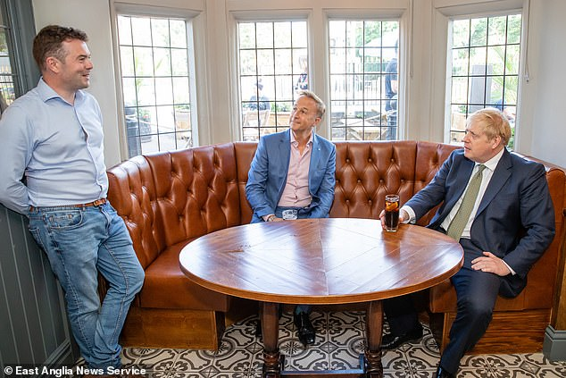 Boris Johnson talks to manager Leigh Phillips (left) and Stonegate CEO Simon Longbottom (centre) at the Crown and Treaty pub in his Uxbridge constituency. He took his mask off for the chat
