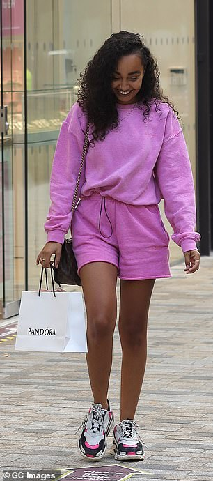 All smiles: Leigh-Anne appeared in high spirits during the trip as she flashed a beaming smile
