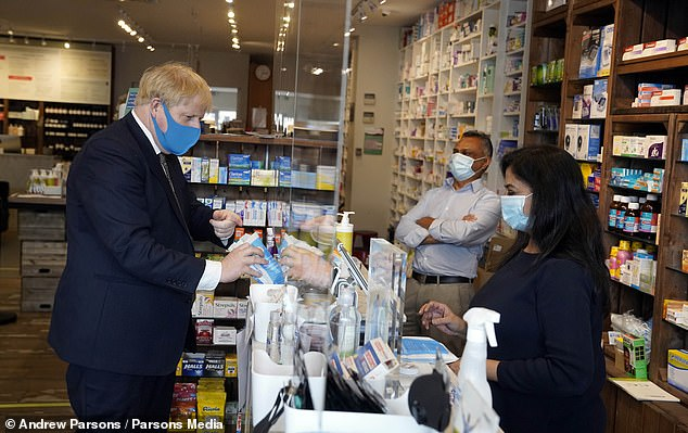 Prime Minister Boris Johnson wearing a face mask in his Uxbridge constituency.The Prime Minister will use an update on virus strategy to press employers to start ordering their staff back to the workplace – if it is safe