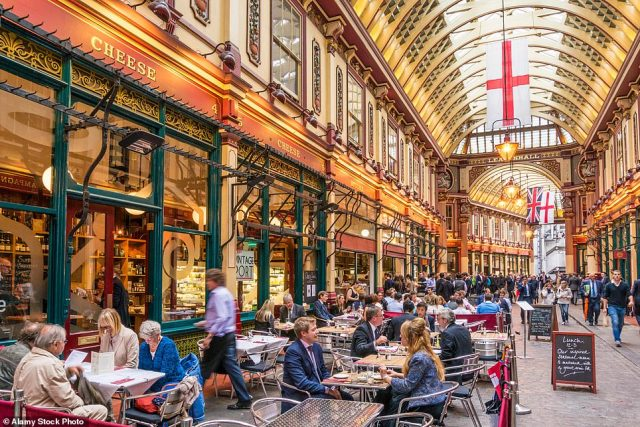Bad for business: Leadenhall Market in the City of London is usually thronged with financial workers doing deals over lunch, but the reopened New Moon pub, right, seems to be struggling to attract customers
