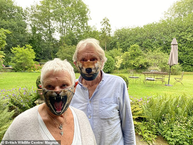 First shot: The Oscar-winning actress revealed on Thursday that she received her first shot last week and will now have to wait 11 weeks for her second encore (pictured with partner David Mills wearing animal masks during the summer)