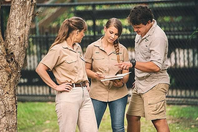 'It was like being open, but with no guests': Terri explained that the zoo was in a 'unique position' of being closed but unable to completely shut down because of the animals and their zoo grounds (Terri pictured left with her daughter Bindi and son-in-law Chandler Powell)