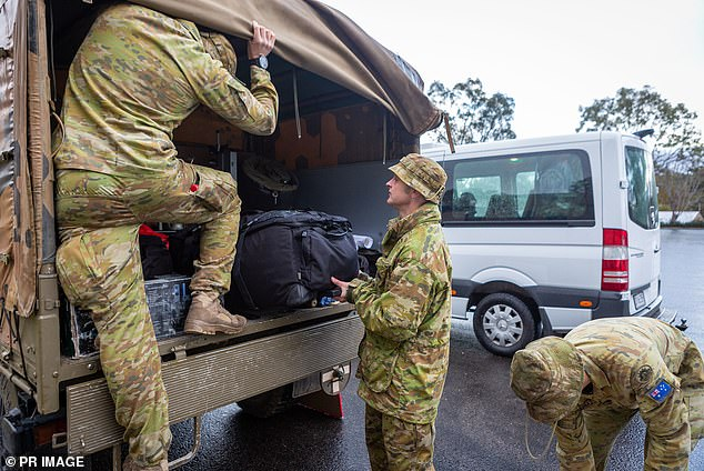 Australian Army personnel depart for Mount Gambier to help block the South Australian border on Saturday