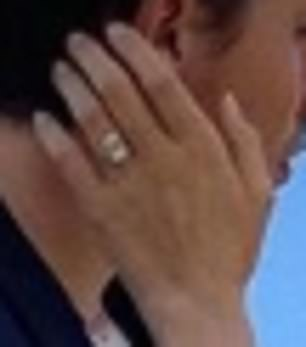 Dazzling! Nicola flashed a glimpse of her dazzling diamond ring in the photograph