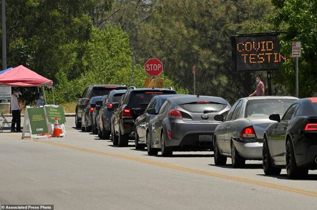 Cars line up for coronavirus testing at Hansen Dam Recreation Center Tuesday in Los Angeles