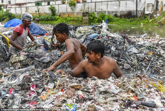Street cleaners in Savar, Dhaka, Bangladesh, may have the worst job in the world as they clean rubbish out a canal in the region