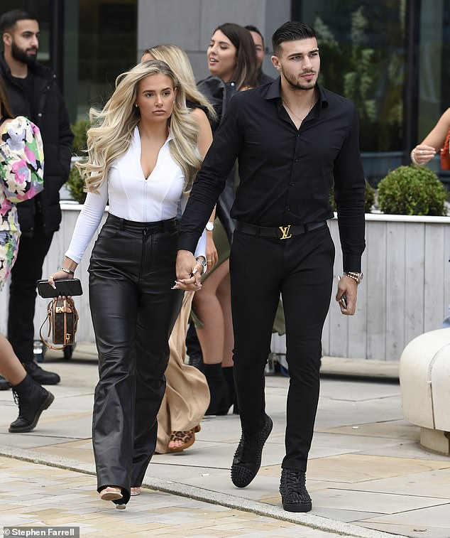 It's a mood: The Love Island star failed to raise a smile, while her boxer beau too looked notably downcast as the couple held hands while making their way to the restaurant