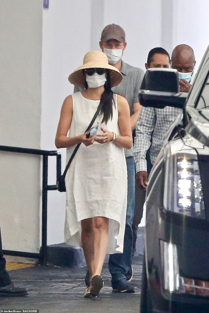 Harry took a few steps behind his wife out of the building in what marked a rare exit for the couple since their move to LA