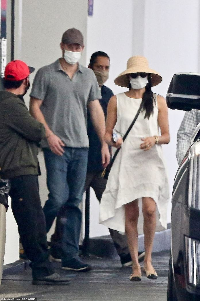 Meghan, who paved the way for their waiting car, dressed for California's scorching weather, with temperatures reaching 84 degrees Fahrenheit and humidity exceeding 67% yesterday