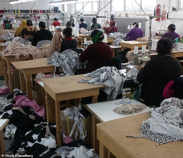 Workshops in Leicester are used to produce incredibly cheap clothes for online retailers. Pictured: Workers at the Faiza Fashion factory in Leicester working despite the Leicester lockdown