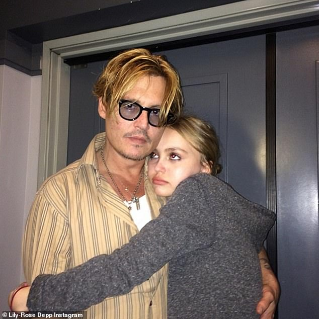 Lily-Rose Depp, pictured right, with her father Johnny, left, wanted to talk to the media outside the High Court in London during his court case in London