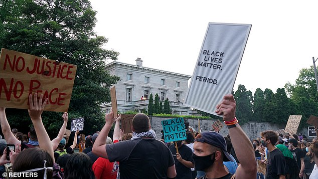 Protesters file past McCloskey's house, in what the residents said was a threatening manner