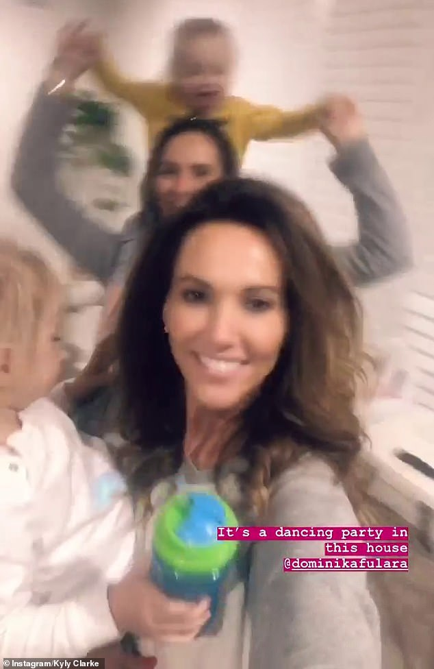 Mums gone wild! Kyly Clarke, 38. enjoyed a dance party with her gal pal on Saturday - as her as daughter Kelsey-Lee continued her fun family getaway with father Michael and his new girlfriend Pip Edwards