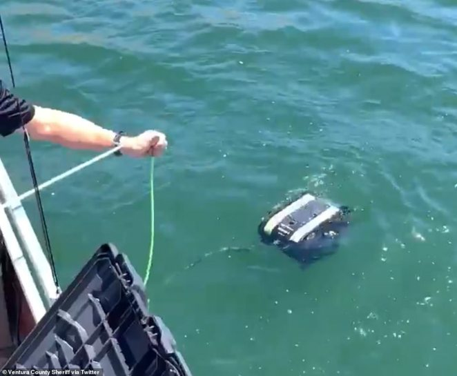 Crew drop the ROV into the water in the hunt for the missing mother-of-one