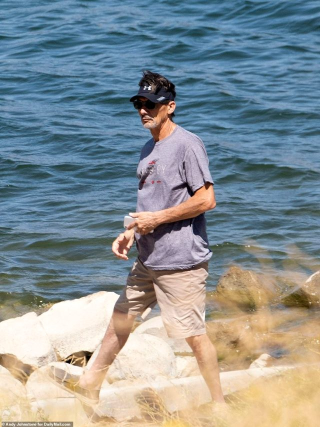 George Rivera, Naya's father, took some time to stand at the edge of the lake and collect his thoughts as he looked at the waters