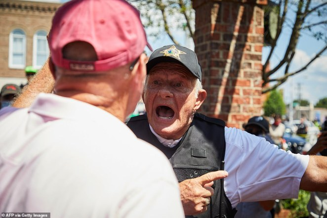 Alamance County Sheriff Terry Johnson tries to calm supporters of the Confederate monument in Graham on Saturday