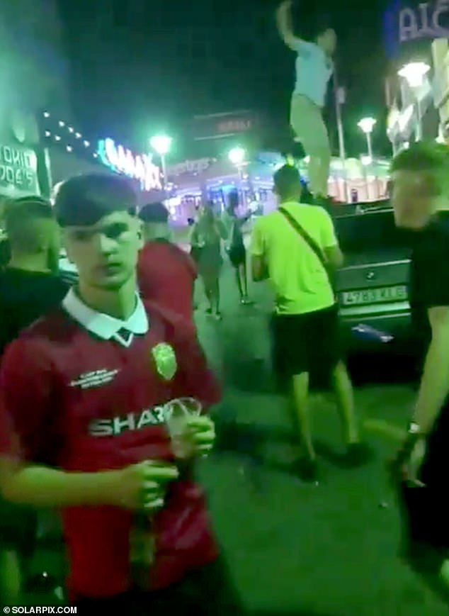 British revellers, who were not wearing face masks, made their return to the Punta Ballena party strip in Magaluf, Spain, shortly after 2am on Friday to begin their booze-fuelled holiday