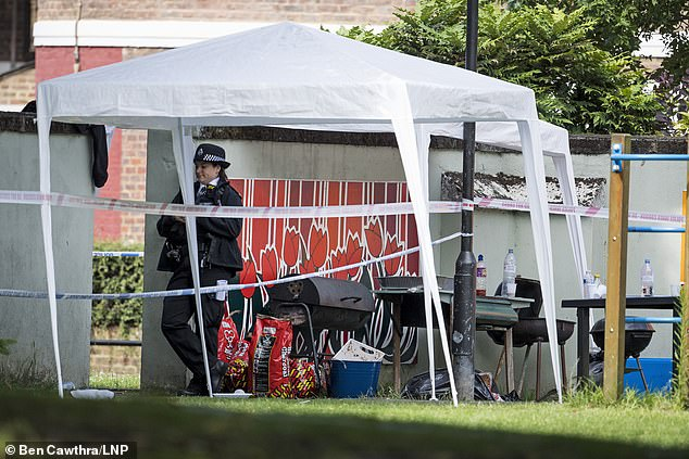 Despite the paramedics' best efforts, the was tragically pronounced dead at the scene on the Black Prince Estate (police at scene, pictured)
