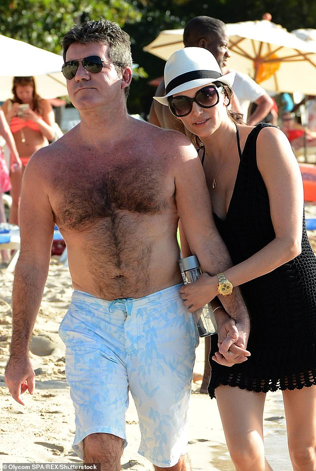 Family Time: He regularly spends time in Barbados with his family, including partner Lauren Silverman.  Photographed together in December 2014