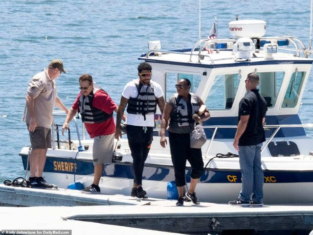 Naya's mom Yolanda and the Glee star's brother Mychal are seen getting off of the Ventura County Sheriff's boats after joining in the search for Naya