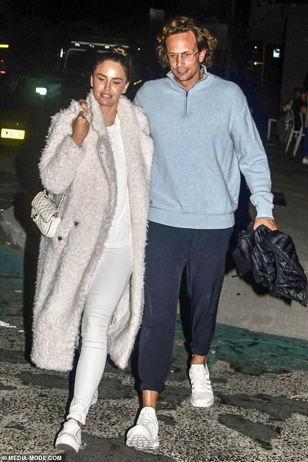 Affectionate: The couple packed on the PDA as they left Japanese eatery Raw Bar in the beachside suburb