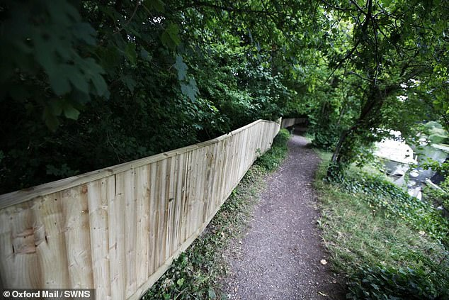 Hollywood director Tim Burton is facing backlash from his neighbours after a 3ft-tall fence (pictured) was erected near his £2.9million Cotswolds home - which locals say blocks their riverside walks